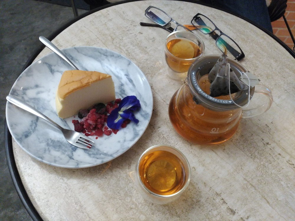 Earl grey and cheesecake at a hipster cafe in Bangkok