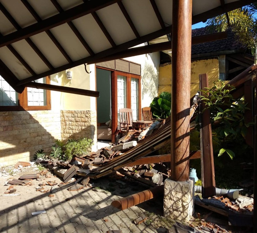 The collapsed front porch. It fell as we stepped outside.