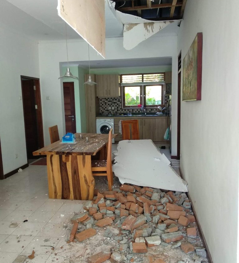The view upon entering the house. The knocked-over chair under the rubble was where I had been sitting...