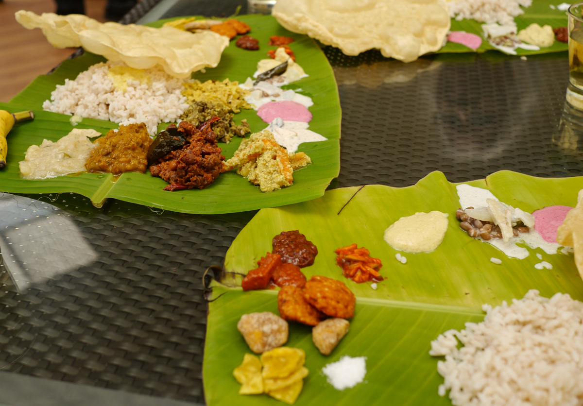 The meal consists of: a mound of Kerala rice on a banana leaf surrounded by chutneys and dry curries; it is eaten in three parts. 1) The dal, 2) the sambar, 3) the buttermilk to cool things down a bit