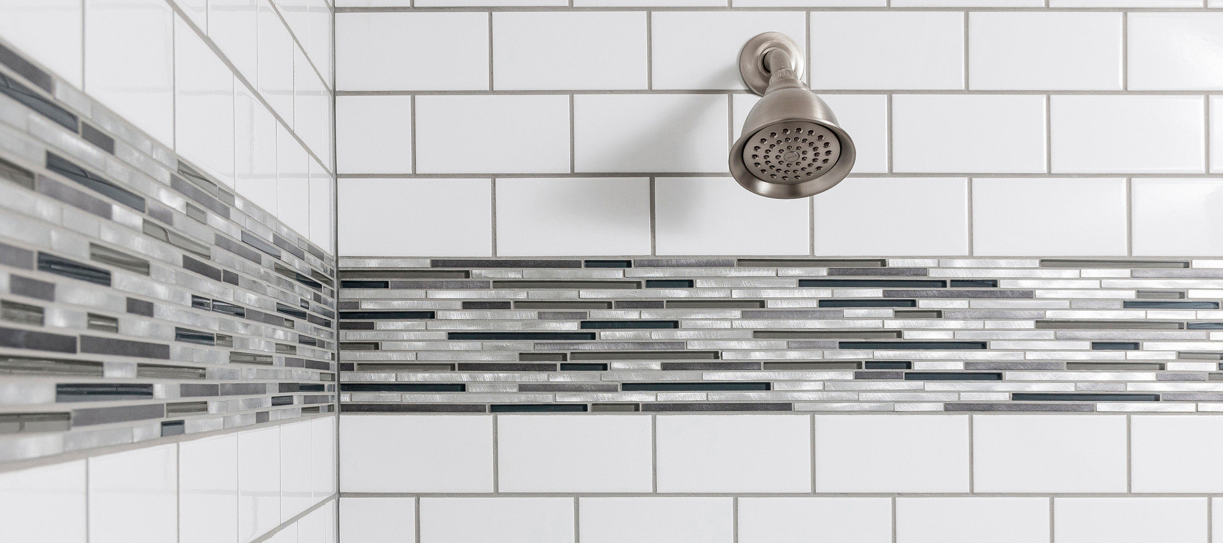 SouthPointe Construction . StudioWerks Custom    Field Tile: Ceramic White 3 x 6        Tile Pattern: 1/2 Offset        Accent Liner: Platinum        Grout: Warm Grey        Tile Pan: Architectural Grey        Tile Pan Grout: Warm Grey  