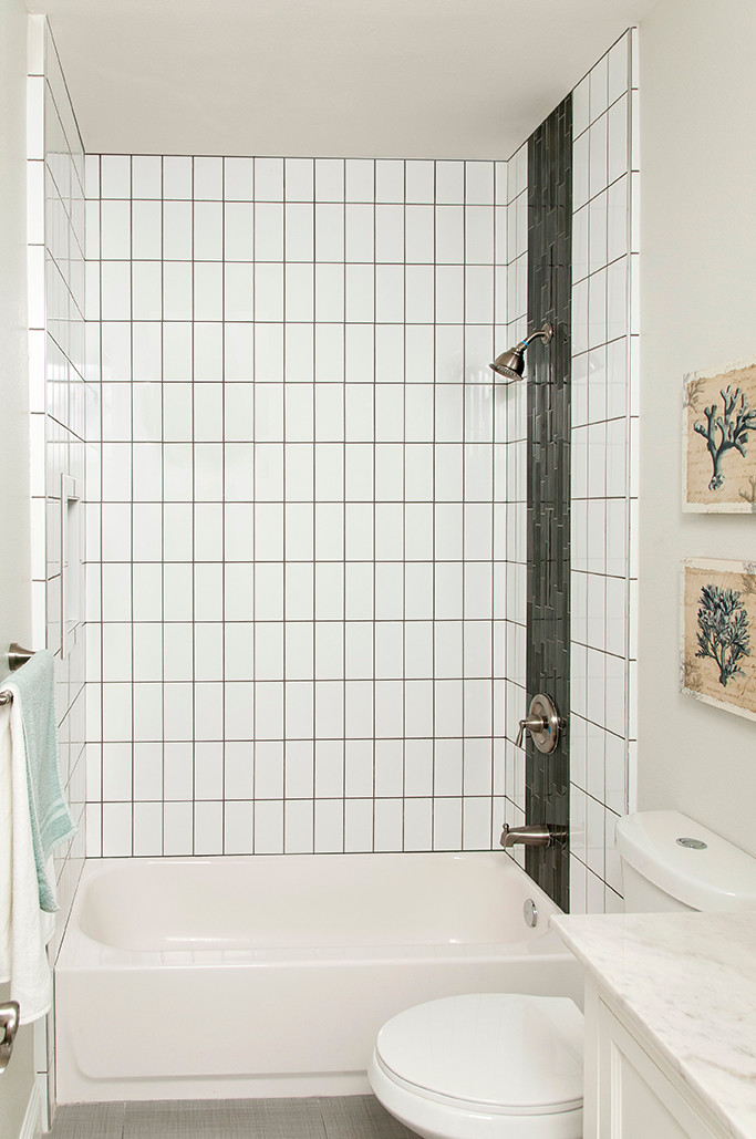 SouthPointe Construction . StudioWerks Custom    Field Tile: White 4 x 6        Grout: Pewter       Tile Pattern: Straight Stack Vertical        Accent Liner: Custom Waterfall  