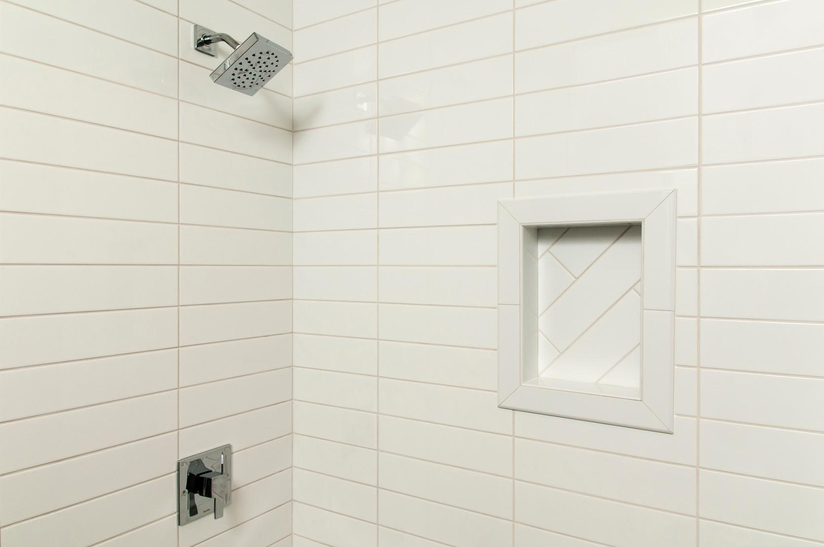 SouthPointe Construction . StudioWerks Custom    Field Tile: White 4 x 16        Tile Pattern: Straight Stack Horizontal        Niche: Ceramic White 