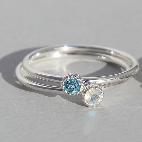 silver ring with round blue topaz