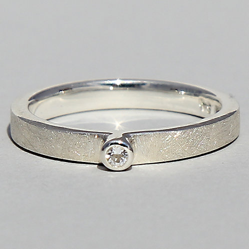 Silver ring with white topaz