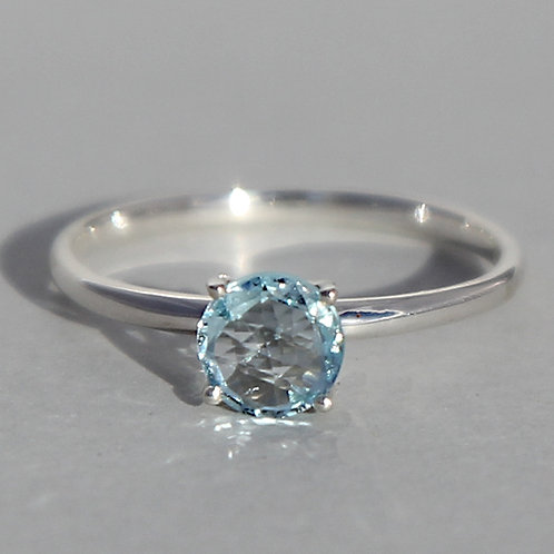 Silver ring with topaz