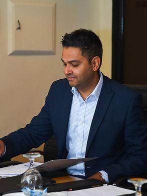 Wasim at desk.jpg