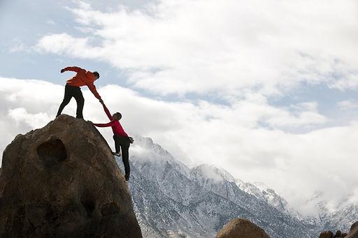 Two people climbing a mountain - Daphne Valcin Coaching - Miami, FL