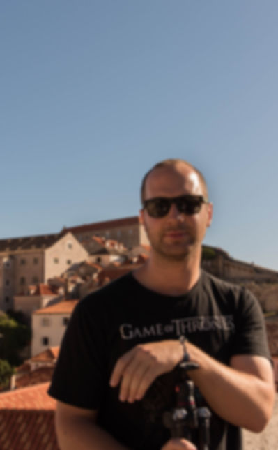 Photographer Dean Haynes on the walls of Dubrovnik, Croatia.