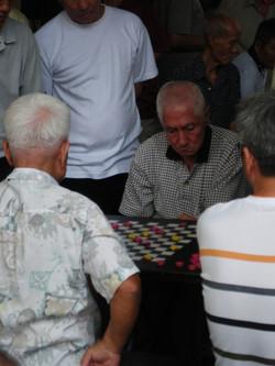 Men playing checkers, Singapore