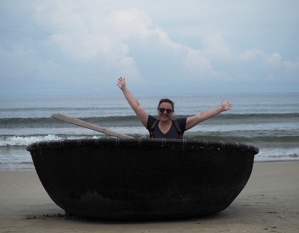 Megan playing in the basket boats - China Beach (Danang) Vietnam - Life Iitinerant