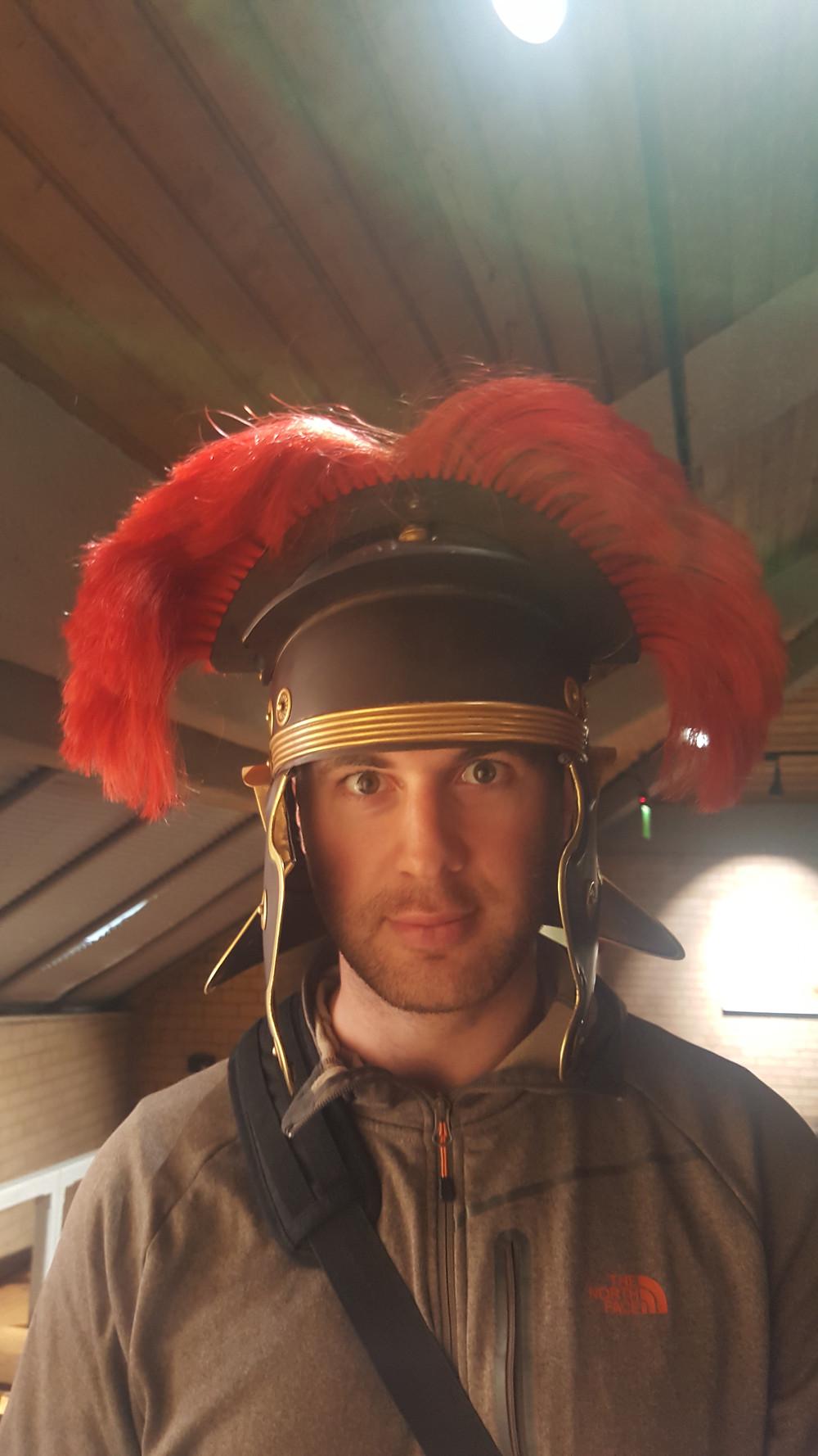 Dean dressing up in a replica roman helmet - New Port, Wales - Life Itinerant