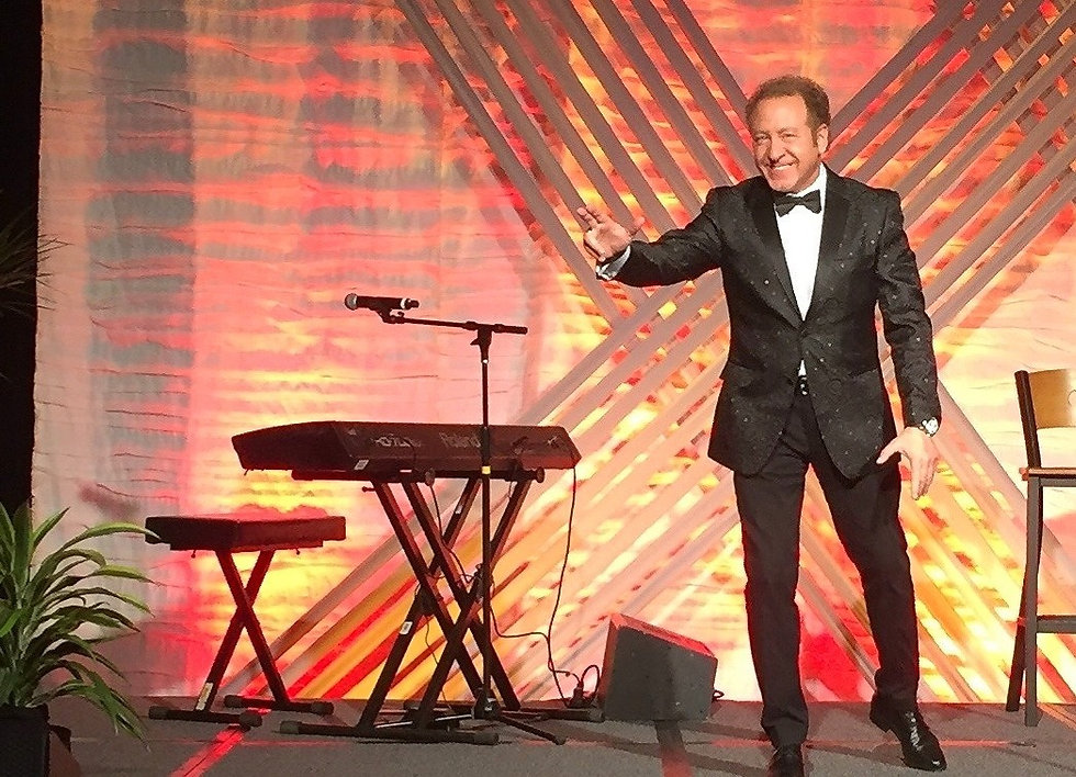 mentalist Sidney Friedman on stage with his corporate entertainment and party entertainment