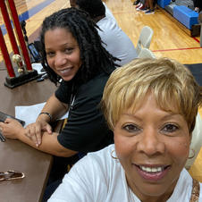 Coach T & Mama Lois holding down the scorer's table
