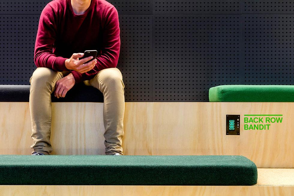 Ubet-person-sitting-raised-seating-cushi