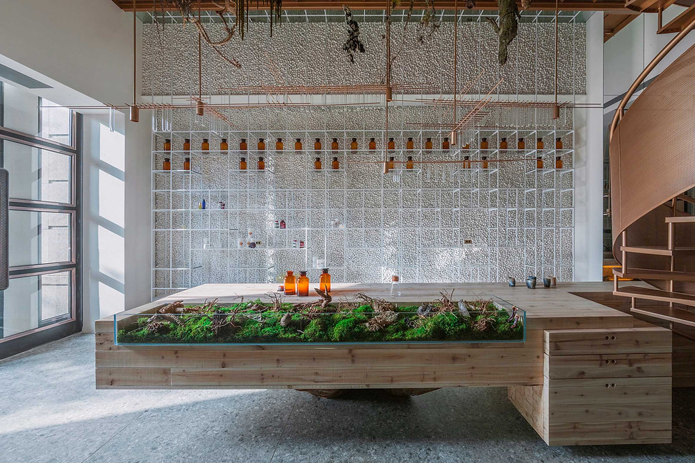 A metal and wood pharmacy design space by Waterform Design