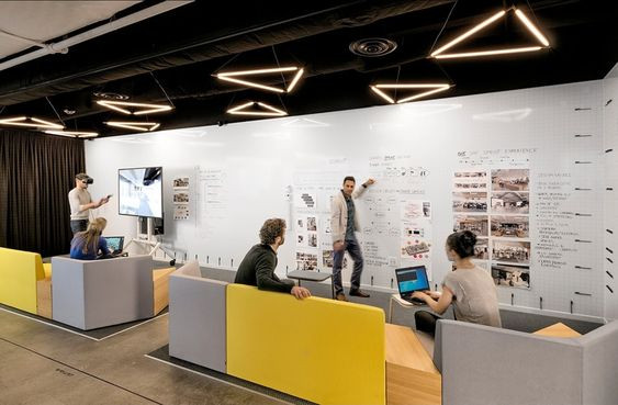 Office team presenting ideas in a shared workspace