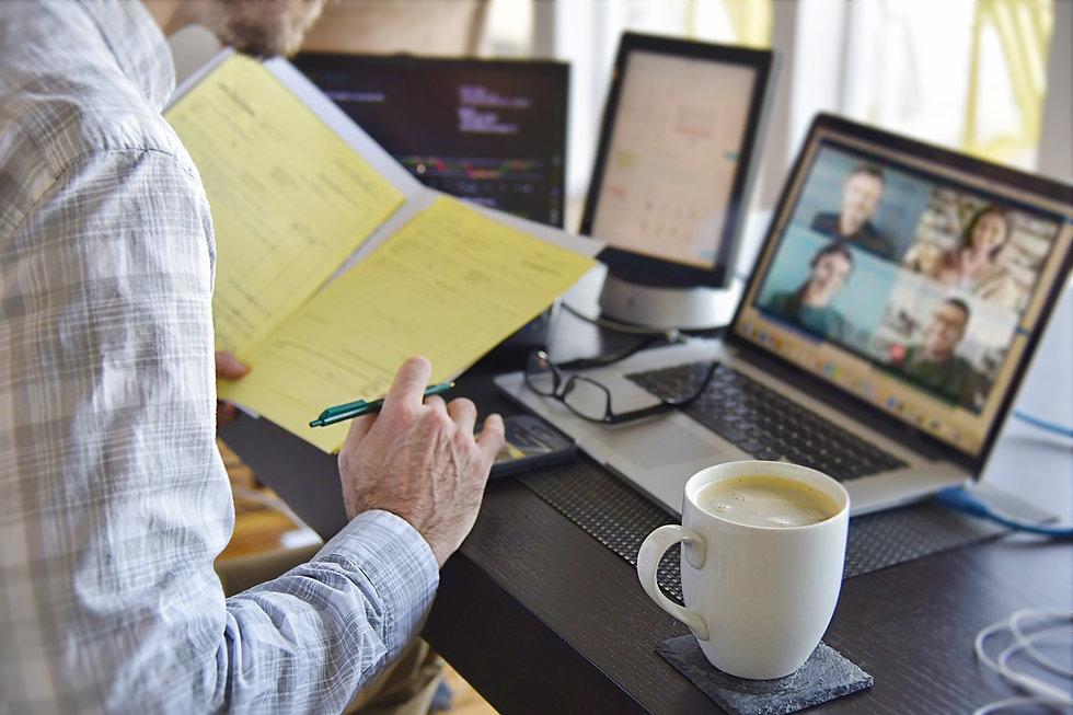 virtual-business-meeting-man-multitaskin