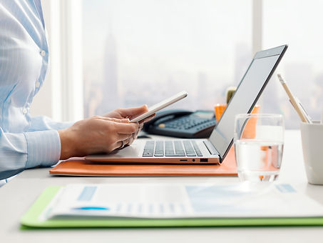 corporate-businesswoman-using-a-digital-tablet-SH7VGU4.jpg