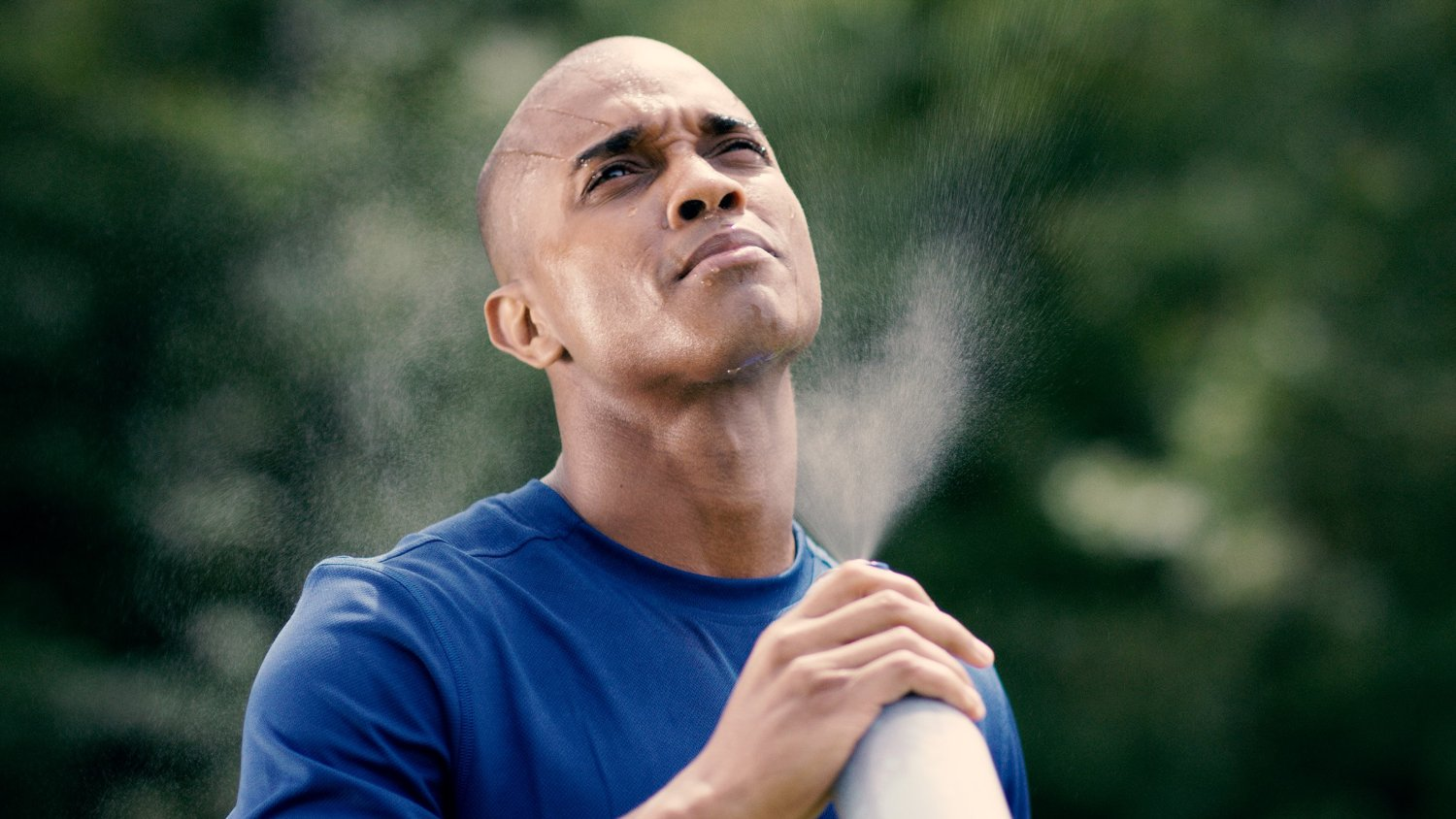 Man-Misting-Himself-with-O2COOL-Mist-n-Spray-Misting-Water-Bottle