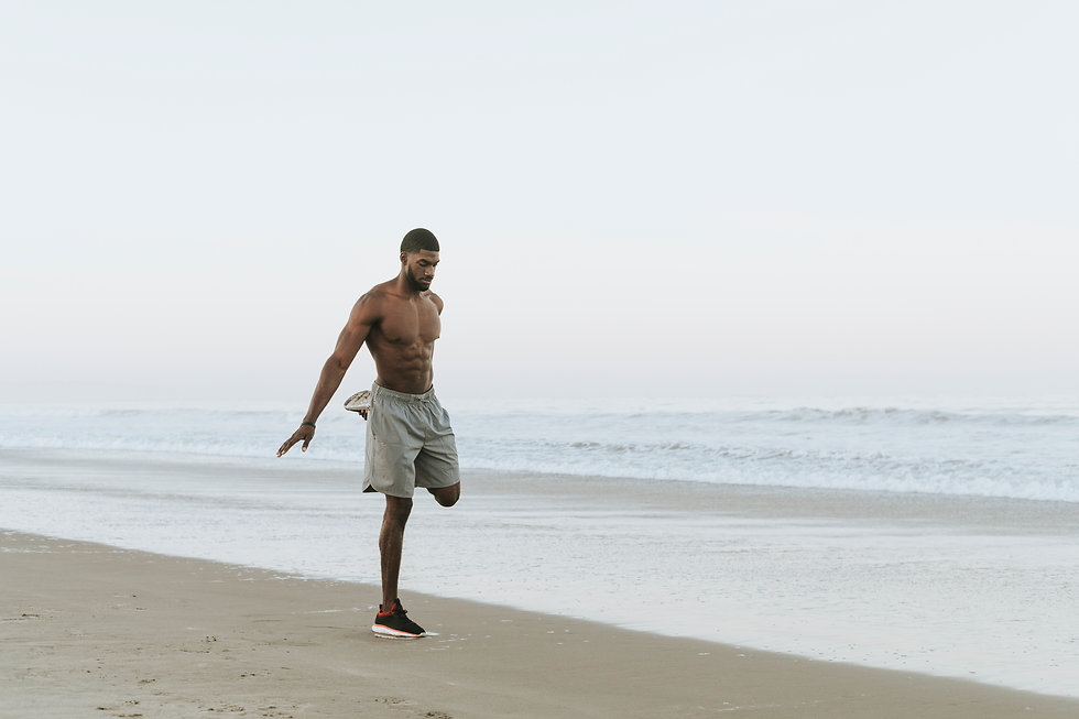 fit-man-stretching-at-the-beach-SBLQWR6.