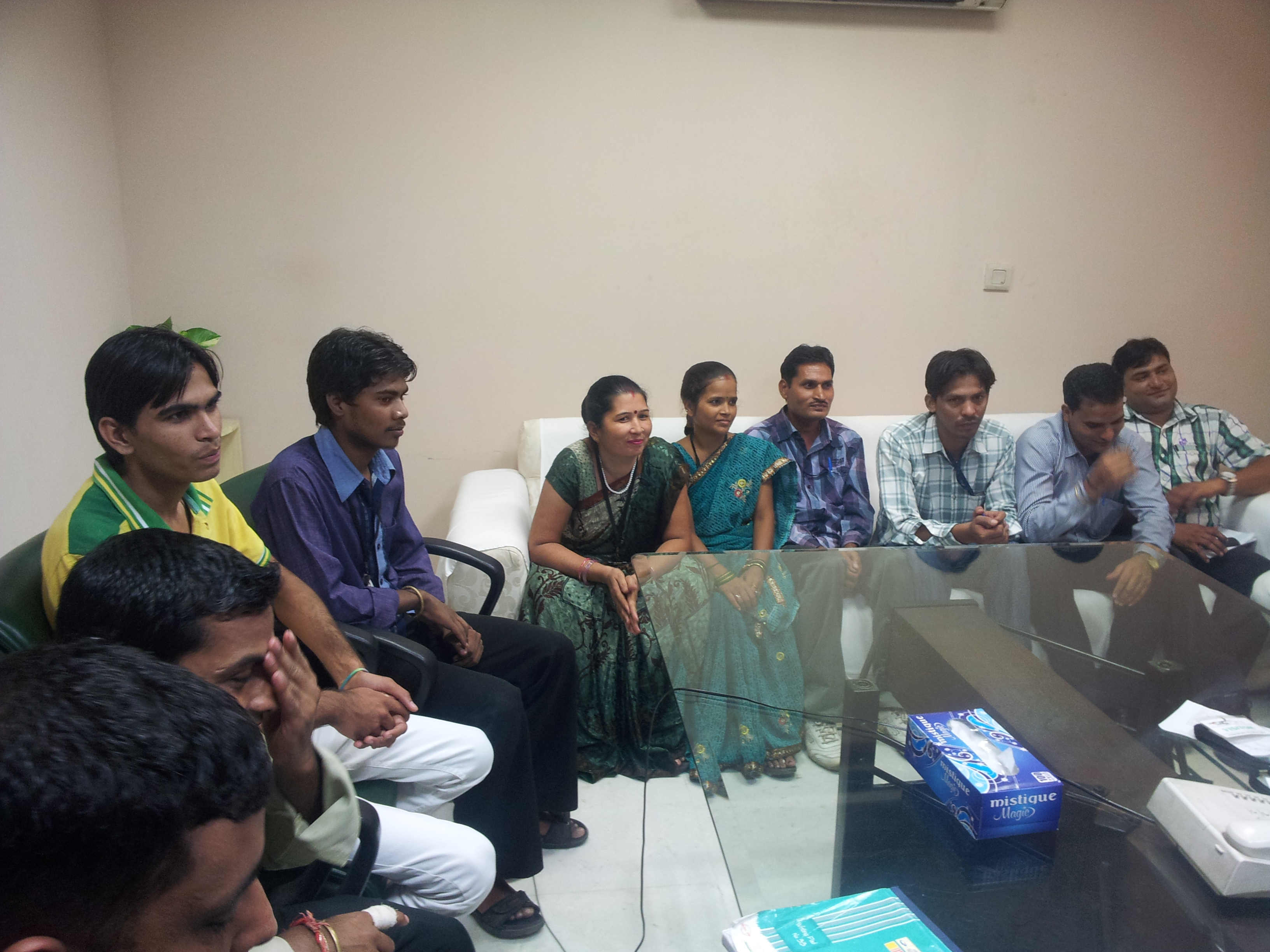 Worker Representatives Assembled in a Conference Room for a Meeting with the Management