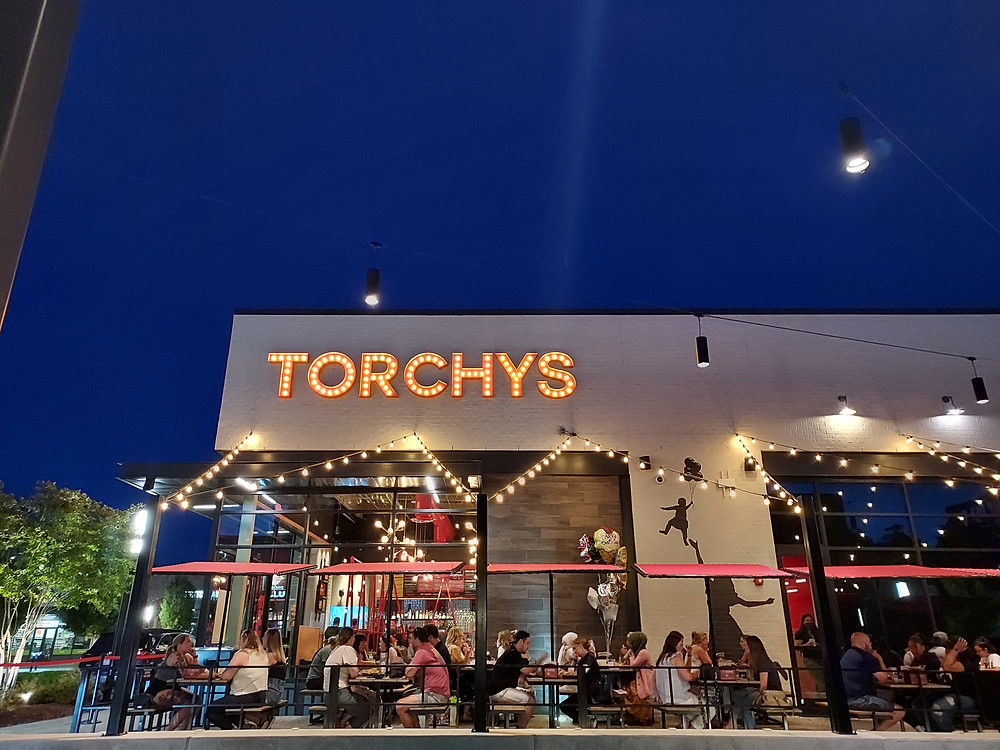 Torchy's patio and sign, all with pretty lights and a gorgeous night sky