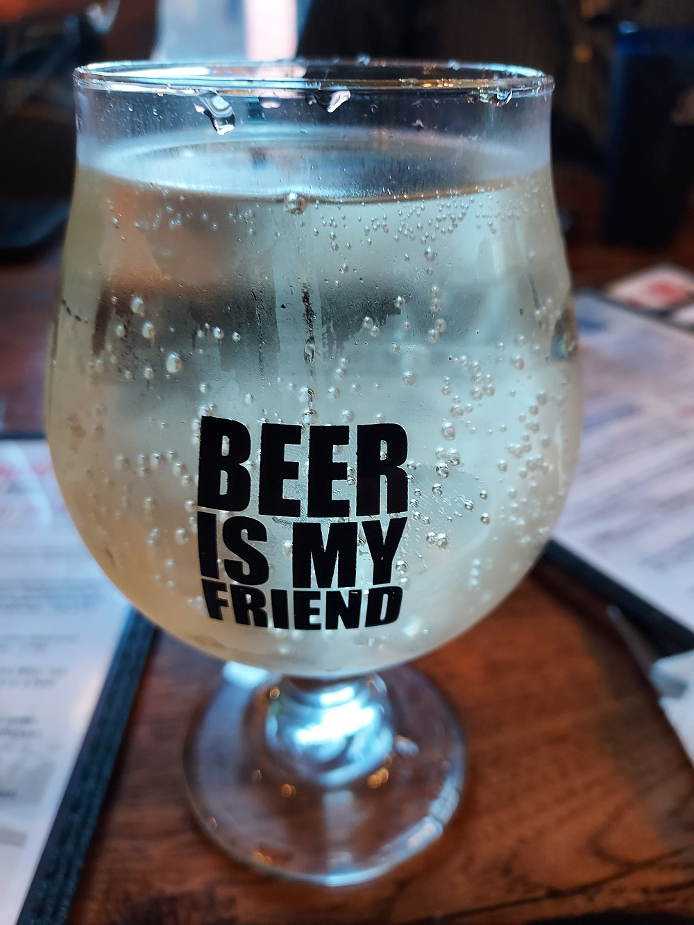 """glass labeled """"beer is my friend"""", even though it is in fact a glass of delicious cider"""