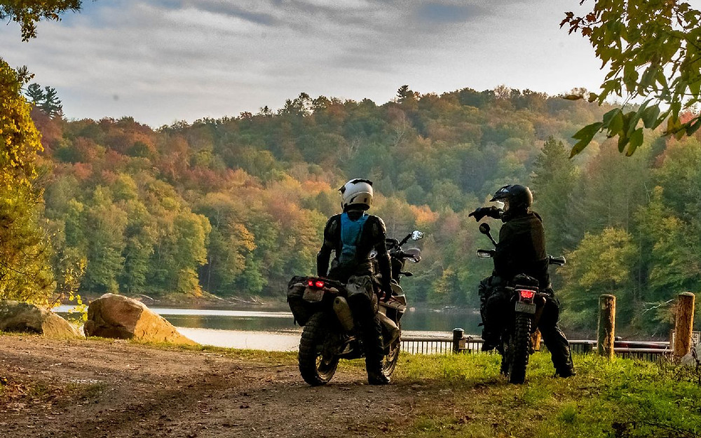 Two riders taking a break on the Northeast Backcountry Discovery Route