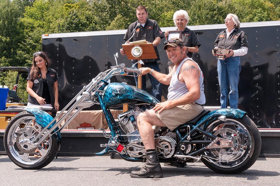 A custom bike builder wins an award at the annual Wilkins Harley Davidson bike show