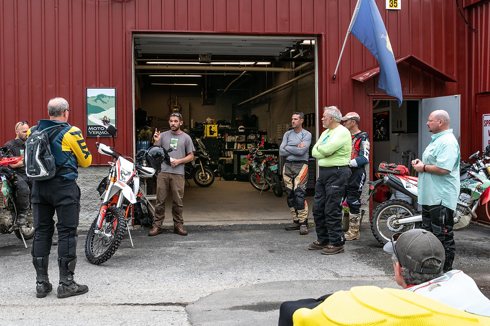 Riders get a ride brief at the beginning of a MotoVermont tour
