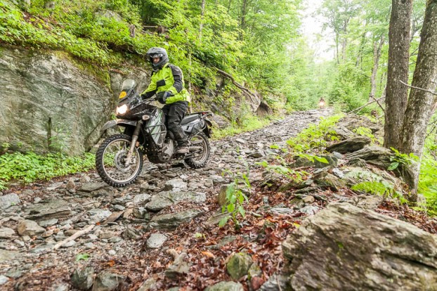 Rider on the MotoVermont Training Tour descends the Bayley-Hazen hero section