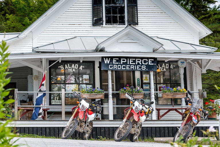Motorcycles parked in front of W. E. Pierce Store