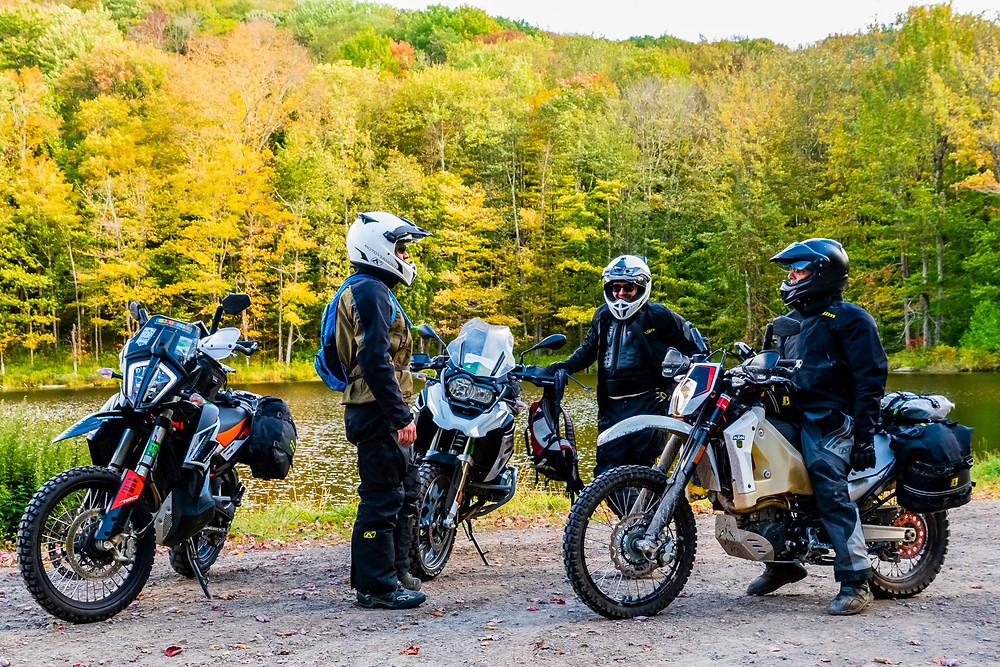Motorcycle riders taking a break on the Northeast Backcountry Discovery route