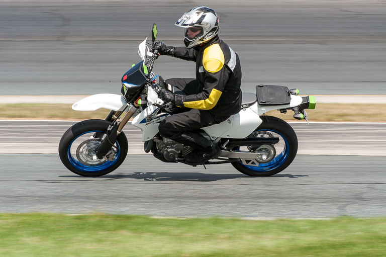Rider from the Cyclewise crew rounds turn 11 at NHMS