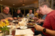 Motorcyclists enjoying a great dinner in the dining room