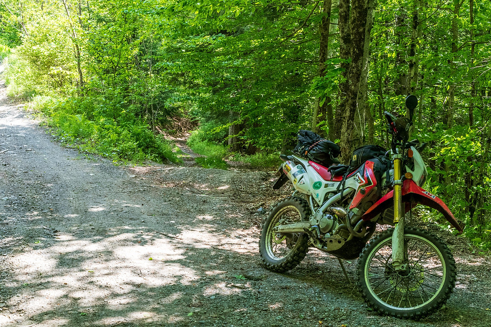 Honda CRF Motorcycle on a class-4 rd in Vermont
