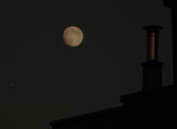 Starship cruising the Moon of June