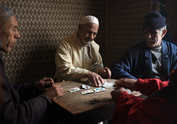 """Men playing """"Ronda"""" with Spanish deck of cards"""