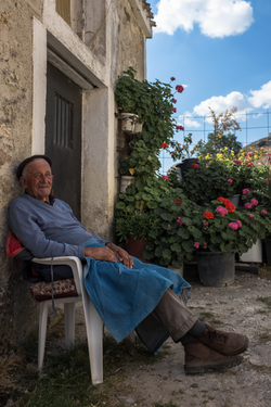 Man with geraniums