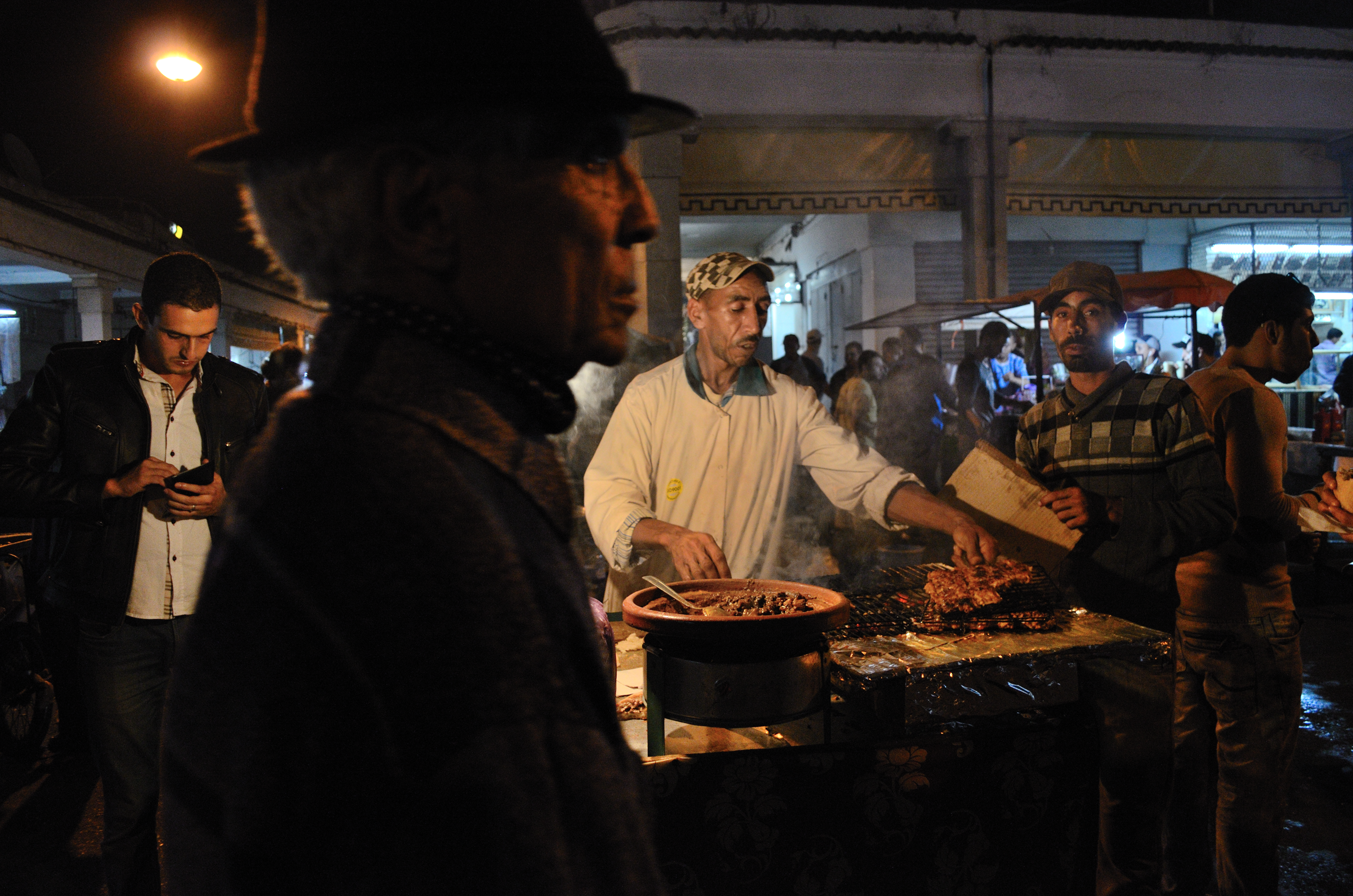 Men in market at night