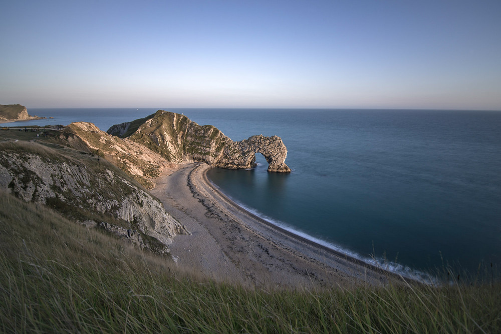 Durdle Door, dorset arc during sunset