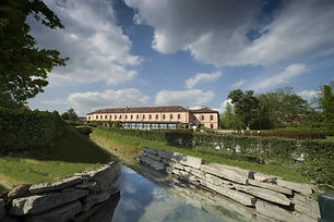 """The Albergo dell'Agenzia hotel in Pollenzo is the brainchild of Slow Food. Endowed with a charm all of its own, it's the ideal place for anyone keen to indulge in the pleasures of the palate. Housed in the same complex as the University of Gastronomic Sciences and the Wine Bank, it's the fruit of painstaking restoration of the neo-Gothic buildings of King Carlo Alberto of Savoy's royal estate. Situated a few kilometres from Alba and Bra, between the Langhe and Roero hills, a UNESCO world heritage site, the hotel has a restaurant, a bar, a summer swimming pool, a private garage and meeting rooms that can seat from 30 to 200 people. Its range of prestigious facilities is rounded off by two hectares of parkland, while the Cherasco Golf Club is just a few minutes away."""