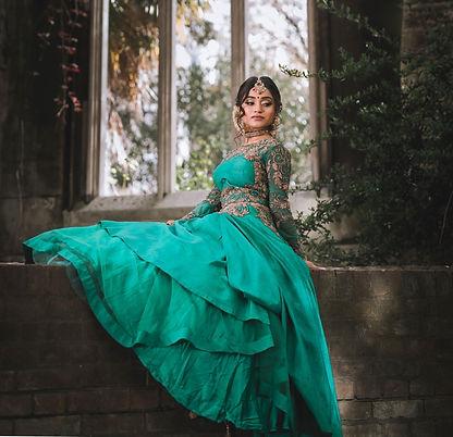 woman in green dress sitting on concrete bench_edited_edited_edited.jpg