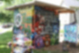 CUBE TURNED RAIN WATER CATCHMENT , STORAGE & ROTATING MURAL SITE