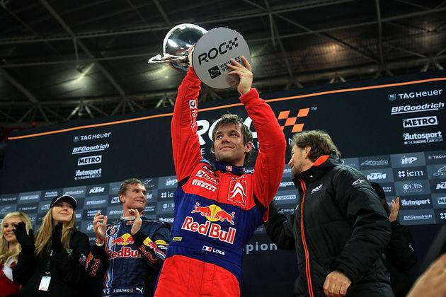 ROC Wembley Stadium 2008_Race Of Champions_Podium_Sebastien Loeb lifts the winner's trophy