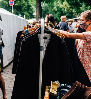 person-shops-for-clothes-in-an-outdoor-m