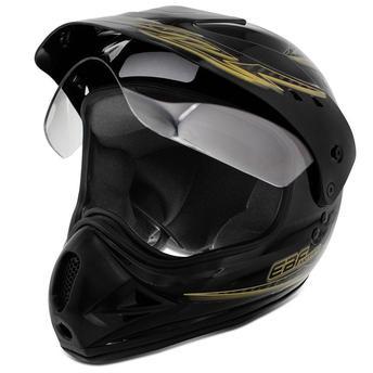 capacete de motocross, preto com dourado e viseira levantada.