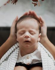freepik-little-baby-sleeping-mother-hands_5932573_edited.jpg