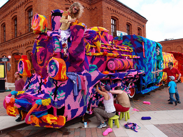 Olek yarn-bombing Locomotive Train in Lodz, Poland